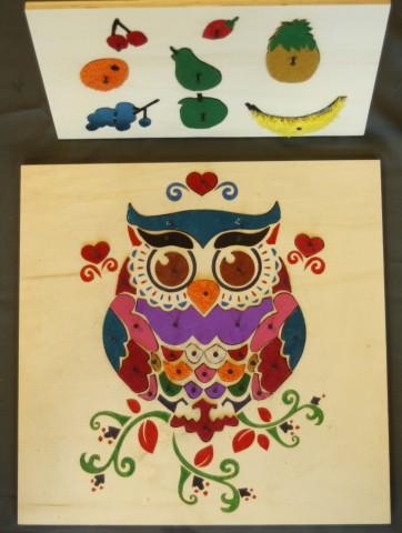 Prototypes Taktila puzzels van een uil en verzameling fruit door stagiaire Sharon de Ronde
